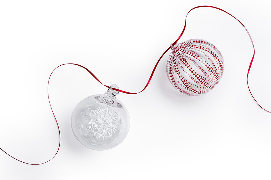 CMoG Holiday Ornaments against White Background with Red Ribbon
