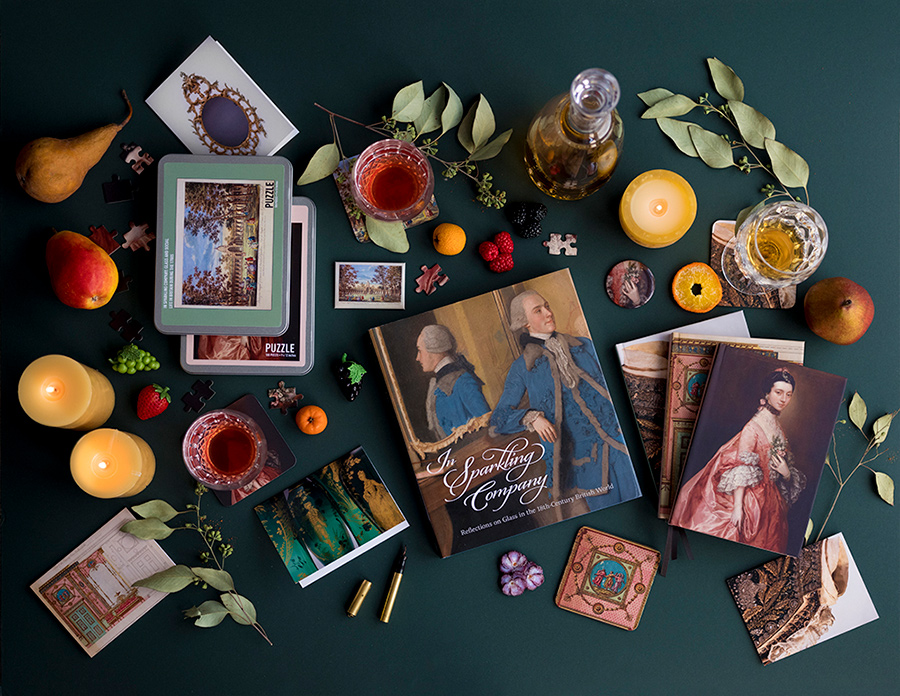 In Sparkling Company book surrounded by related products and various decorations against a rich blue green background