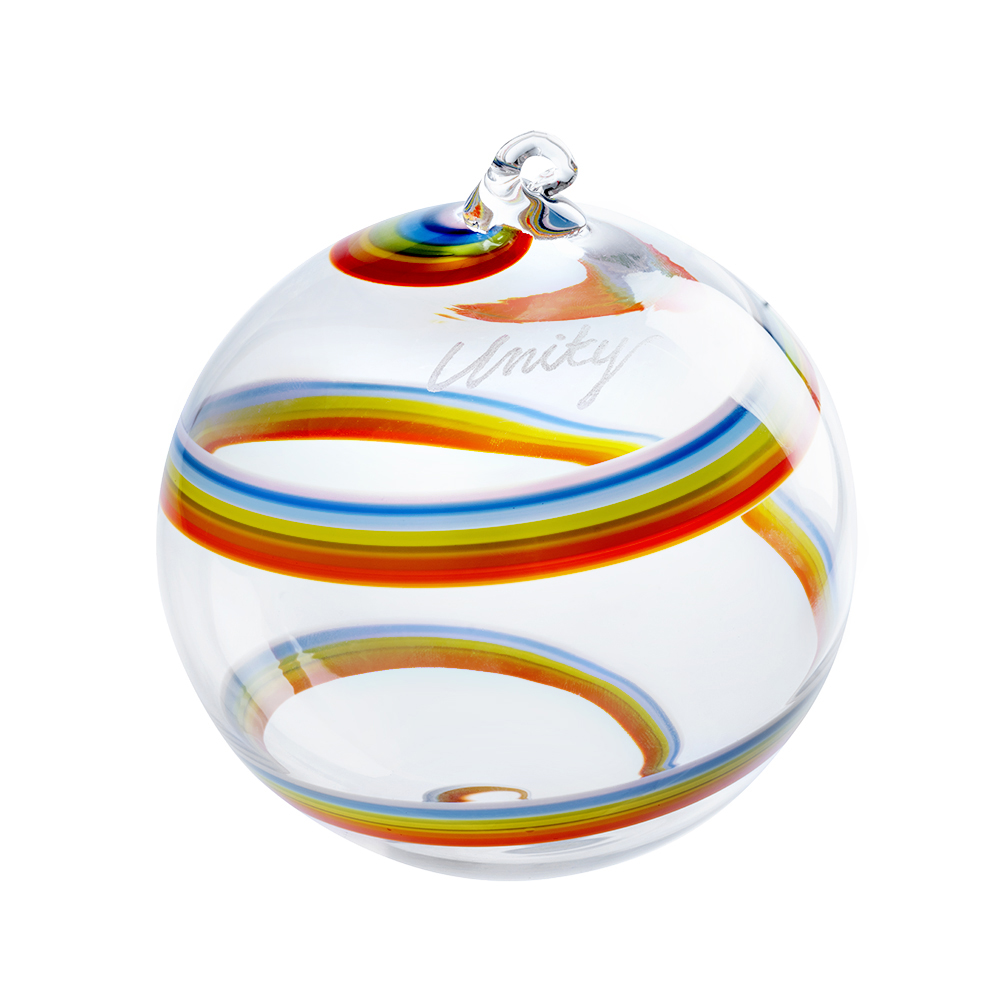 Clear blown ornament with rainbow cane wrapped around it