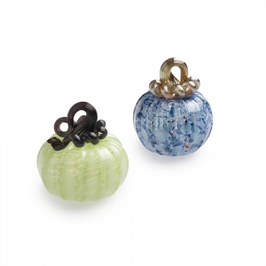 Two glass pumpkins, one blue with gold stem and one celadon with black stem