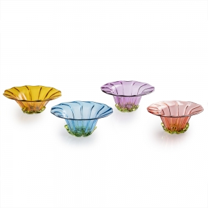 Four colorful fluted bowls with green accents around the base