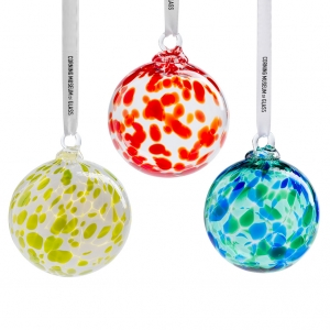 Three multicolor round ornaments