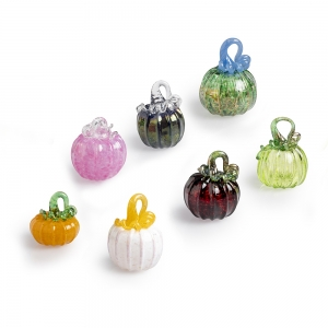 Seven small colorful glass pumpkins