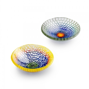 Two fused glass bowls with rainbow colors, one with dark center and one with light center