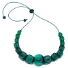 Necklace with 15 large teal hollow beads spaced with smaller beads in between them with bead at the end of the necklace to tighten it